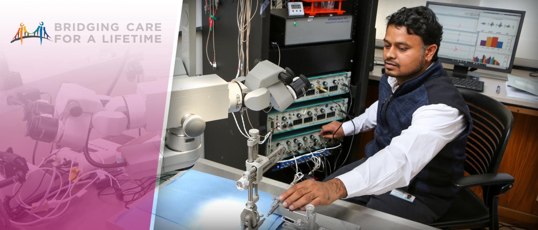 Man using a microscope and scientific equipment
